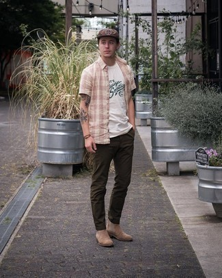 1200+ Outfits For Men In Their 20s: Extremely stylish and practical, this laid-back combination of a pink gingham short sleeve shirt and dark brown chinos delivers amazing styling opportunities. Hesitant about how to complement your getup? Finish off with tan suede chelsea boots to step up the style factor. This ensemble shows how to kill it in the casual style department as a young adult.