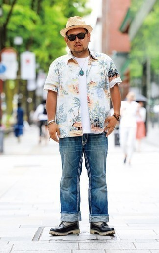 How To Wear Blue Jeans With Black Leather Boots For Men: Marrying a white print short sleeve shirt with blue jeans is an amazing pick for a casual but on-trend ensemble. Here's how to bring an added dose of class to this look: black leather boots.
