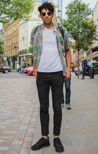 How to Wear Black Jeans For Men: Make a multi colored print short sleeve shirt and black jeans your outfit choice for a daily look that's full of style and character. Black athletic shoes introduce a more dressed-down aesthetic to the look.