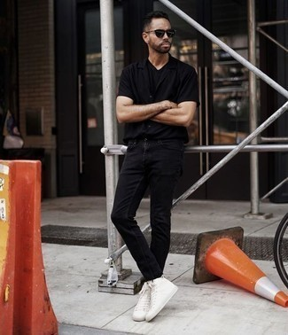 How to Wear White Canvas High Top Sneakers For Men: This pairing of a black short sleeve shirt and black jeans is solid proof that a pared down off-duty getup doesn't have to be boring. Let your styling prowess really shine by completing your ensemble with a pair of white canvas high top sneakers.