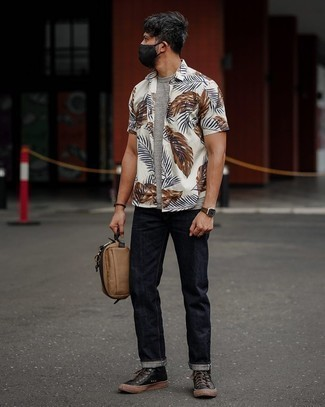 White Print Short Sleeve Shirt Outfits For Men: Rock a white print short sleeve shirt with navy jeans for standout menswear style. Look at how great this getup is complemented with a pair of black leather low top sneakers.