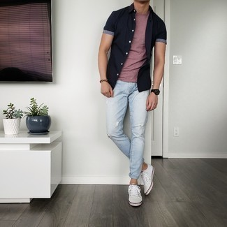 Men's Outfits 2021: Such items as a black short sleeve shirt and light blue ripped jeans are the ideal way to inject understated dapperness into your day-to-day casual rotation. Want to go all out on the shoe front? Complete this look with a pair of white canvas low top sneakers.