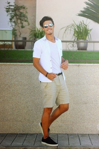 Look stylish yet practical in a white short sleeve shirt and a Diesel Layered Bracelet. This outfit is complemented perfectly with black canvas low top sneakers. We love how you can sport this getup throughout the summertime.