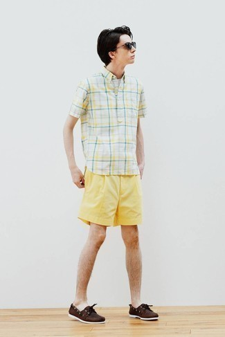 Dark Brown Leather Boat Shoes Outfits: Consider pairing a white plaid short sleeve shirt with yellow shorts for a cool and casual and stylish ensemble. If in doubt as to the footwear, go with dark brown leather boat shoes.