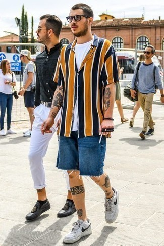 Blue Denim Shorts Outfits For Men: Reach for a multi colored vertical striped short sleeve shirt and blue denim shorts to put together an everyday look that's full of style and personality. If you're hesitant about how to finish off, a pair of grey leather low top sneakers is a surefire option.