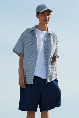 Men's Outfits 2021: Who said you can't make a style statement with a casual ensemble? Draw the attention in a white and navy vertical striped short sleeve shirt and navy shorts.