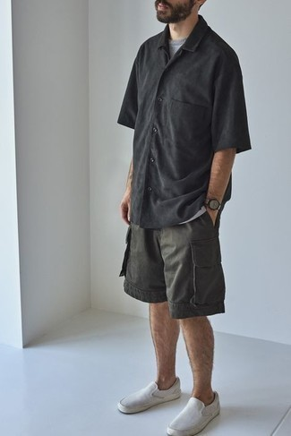Grey Crew-neck T-shirt Outfits For Men: This combination of a grey crew-neck t-shirt and charcoal shorts is irrefutable proof that a simple casual getup doesn't have to be boring. And if you need to effortlessly lift up this getup with a pair of shoes, why not add white canvas slip-on sneakers?