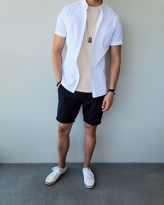 White Short Sleeve Shirt Outfits For Men: Sharp yet comfortable, this outfit is comprised of a white short sleeve shirt and navy shorts. On the shoe front, this ensemble is completed well with white canvas low top sneakers.