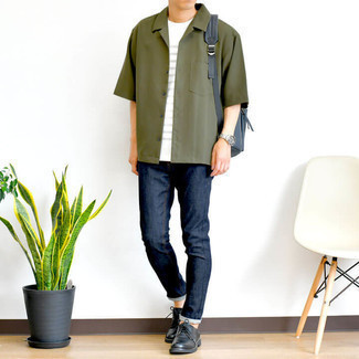 Navy Skinny Jeans Outfits For Men: We say a big yes to this relaxed combo of an olive short sleeve shirt and navy skinny jeans! To bring a little flair to this ensemble, complement your look with black leather derby shoes.