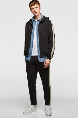 Black Track Suit Outfits For Men: If you love laid-back combos, then you'll love this combo of a black track suit and a light blue chambray short sleeve shirt. And if you wish to instantly class up your outfit with a pair of shoes, complete this ensemble with white leather low top sneakers.