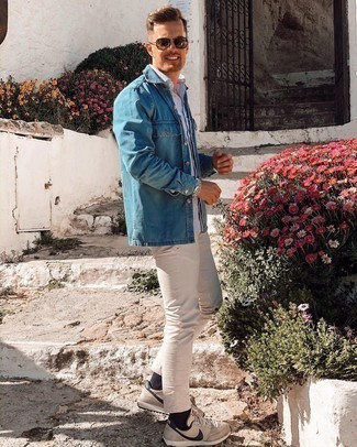 Denim Shirt Outfits For Men: This pairing of a denim shirt and beige chinos is extremely easy to pull together and so comfortable to wear as well! Beige athletic shoes are the simplest way to infuse a dash of stylish effortlessness into this outfit.