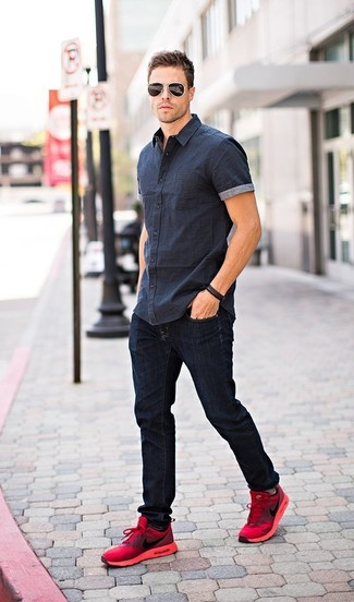 How to wear: navy short sleeve shirt, navy jeans, red athletic shoes, black sunglasses