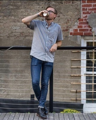 How to Wear Blue Jeans For Men: If you're a fan of classic combos, then you'll like this combo of a light blue short sleeve shirt and blue jeans. Let your styling chops truly shine by rounding off your look with black leather casual boots.