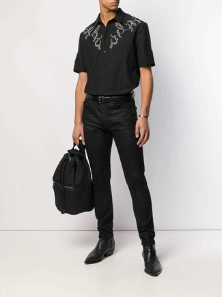 How to wear: black embroidered short sleeve shirt, black jeans, black leather chelsea boots, black canvas backpack