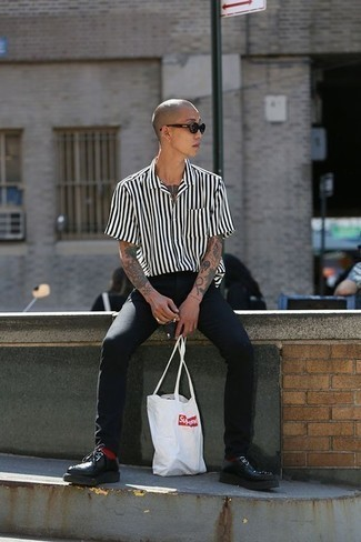 How to Wear Black Jeans For Men: Consider teaming a white and black vertical striped short sleeve shirt with black jeans for comfort dressing with a fashionable spin. Unimpressed with this outfit? Invite black chunky leather derby shoes to change things up a bit.