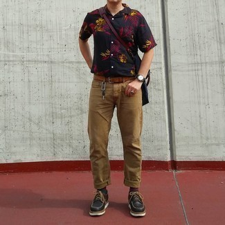 Black Chunky Leather Derby Shoes Outfits: Extremely dapper and practical, this casual combination of a black floral short sleeve shirt and khaki jeans will provide you with ample styling possibilities. On the fence about how to complete your outfit? Wear a pair of black chunky leather derby shoes to dial up the style factor.
