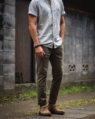 Black Socks Outfits For Men: You're looking at the indisputable proof that a light blue linen short sleeve shirt and black socks look awesome when teamed together in a casual outfit. If you need to easily spruce up your look with shoes, why not finish off with a pair of tan suede desert boots?