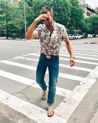 How to wear: beige print short sleeve shirt, teal jeans, grey suede sandals, dark brown leather belt