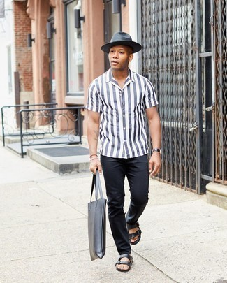 Sandals Outfits For Men: This pairing of a white vertical striped short sleeve shirt and black jeans is proof that a pared down off-duty outfit can still be seriously sharp. To inject a fun vibe into this outfit, add a pair of sandals to the equation.