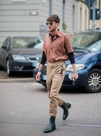 How to Wear a Pink Short Sleeve Shirt For Men: This combination of a pink short sleeve shirt and khaki chinos makes for the ultimate casual style for any gent. Serve a little mix-and-match magic by slipping into a pair of dark green leather chelsea boots.