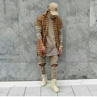 How to wear: tan plaid short sleeve shirt, beige long sleeve t-shirt, grey crew-neck t-shirt, beige ripped skinny jeans