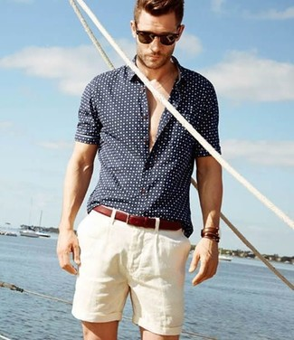 A navy and white polka dot short sleeve shirt and shorts is a wonderful combination to add to your styling repertoire.