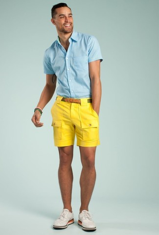 How To Wear a Light Blue Gingham Short Sleeve Shirt With Yellow Shorts For Men: Dapper yet functional, this outfit is comprised of a light blue gingham short sleeve shirt and yellow shorts. Bring a more sophisticated twist to an otherwise everyday outfit by slipping into white leather brogues.