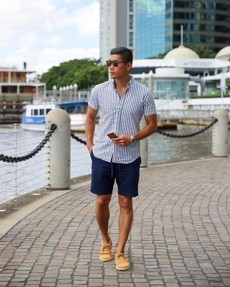 Navy Shorts with Suede Dress Shoes Smart Casual Summer Outfits For Men: This casual pairing of a white and blue vertical striped short sleeve shirt and navy shorts is a tested option when you need to look casually cool but have zero time. Balance your look with a more elegant kind of shoes, such as these suede dress shoes. Totally appropriate for super hot summertime days, you can work this outfit throughout the summer season.
