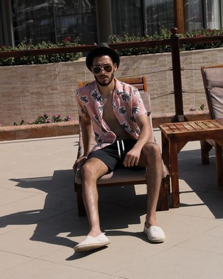 Shorts Outfits For Men: Consider wearing a pink print short sleeve shirt and shorts to put together a cool and casual getup. Let your sartorial expertise really shine by finishing this outfit with grey horizontal striped canvas espadrilles.