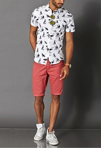 How to wear: white and black print short sleeve shirt, red denim shorts, white canvas high top sneakers, olive sunglasses