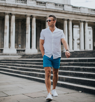 How to wear: white print short sleeve shirt, blue shorts, white low top sneakers, black sunglasses