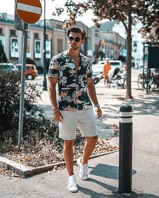 How to Wear a Silver Bracelet For Men: Try pairing a navy floral short sleeve shirt with a silver bracelet for relaxed dressing with an edgy spin. For something more on the classier end to round off your ensemble, add white canvas low top sneakers to your look.