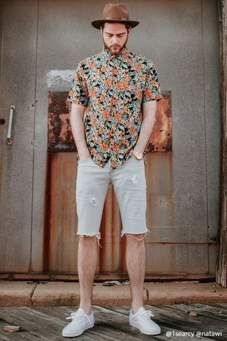 Light Blue Ripped Denim Shorts Outfits For Men: This ensemble with a multi colored floral short sleeve shirt and light blue ripped denim shorts isn't super hard to pull off and is easy to change. A pair of white canvas low top sneakers easily dials up the fashion factor of any outfit.