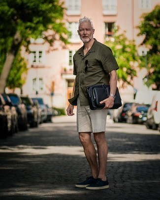 Shorts Outfits For Men: This cool and casual ensemble is easy to break down: an olive short sleeve shirt and shorts. A pair of navy canvas low top sneakers looks wonderful here.