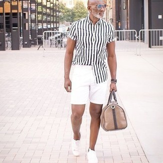 1200+ Outfits For Men After 50: For a look that offers comfort and dapperness, team a white and black vertical striped short sleeve shirt with white shorts. For extra fashion points, introduce white canvas low top sneakers to your ensemble. This ensemble shows how to stay stylish as you pass the big 5-0.