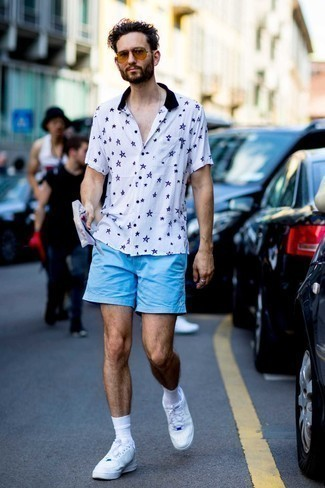 White and Red Leather Low Top Sneakers Outfits For Men: Hard proof that a white star print short sleeve shirt and light blue shorts are amazing when teamed together in a laid-back outfit. Our favorite of a countless number of ways to complete this outfit is with white and red leather low top sneakers.
