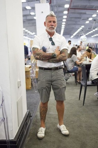 How to Wear Grey Shorts For Men: For an off-duty outfit, go for a white short sleeve shirt and grey shorts — these items go perfectly well together. A pair of white leather monks immediately turns up the style factor of any getup.