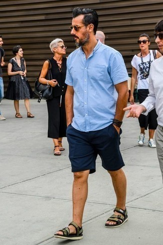 How to Wear Navy Shorts For Men: This combo of a light blue short sleeve shirt and navy shorts is an obvious choice for off duty. For something more on the daring side to complement your ensemble, introduce olive canvas sandals to the equation.
