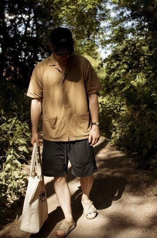 Tan Short Sleeve Shirt Outfits For Men: A tan short sleeve shirt and black shorts are among the key elements in any modern gent's great casual sartorial collection. Feeling venturesome? Dial down your outfit by finishing with beige suede sandals.