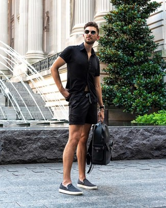 How to wear: black short sleeve shirt, black shorts, navy canvas slip-on sneakers, black leather backpack