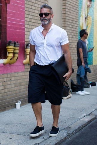 How to Wear a White Short Sleeve Shirt For Men: Marrying a white short sleeve shirt with navy shorts is a wonderful choice for a relaxed casual yet dapper look. Add a pair of navy canvas slip-on sneakers to your ensemble and off you go looking spectacular.