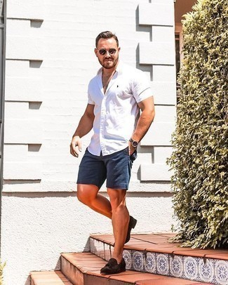 Navy Shorts with Suede Dress Shoes Smart Casual Summer Outfits For Men: A white short sleeve shirt and navy shorts are a good pairing that will carry you throughout the day. For a smarter finish, introduce suede dress shoes to your look. If you're trying to figure out a summer-ready outfit, this here is your inspiration.