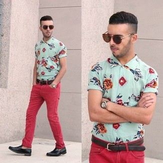 For an everyday outfit that is full of character and personality pair a floral short sleeve shirt with red corduroy skinny jeans. A cool pair of black leather loafers is an easy way to upgrade your look.