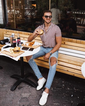 How to Wear a White and Red Vertical Striped Short Sleeve Shirt For Men: If you're looking for a contemporary but also sharp ensemble, make a white and red vertical striped short sleeve shirt and light blue ripped skinny jeans your outfit choice. If you want to feel a bit more polished now, complement your look with white leather low top sneakers.