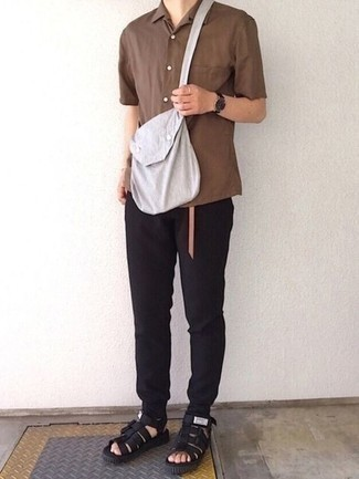 Sandals Outfits For Men: A brown short sleeve shirt and black sweatpants teamed together are a match made in heaven for those dressers who love casual combinations. Bump up this look by rounding off with a pair of sandals.