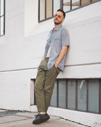 How to wear: white and blue vertical striped short sleeve shirt, white tank, olive chinos, black leather low top sneakers