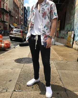 How to Wear White Canvas Slip-on Sneakers For Men: When the situation permits casual dressing, team a white floral short sleeve shirt with black chinos. When in doubt as to the footwear, add a pair of white canvas slip-on sneakers to this outfit.