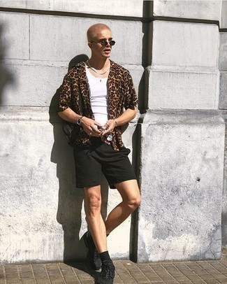 How to Wear Black Athletic Shoes For Men: For a look that's pared-down but can be modified in a ton of different ways, consider teaming a brown leopard short sleeve shirt with black shorts. Finishing off with black athletic shoes is a surefire way to introduce a dash of stylish casualness to your look.