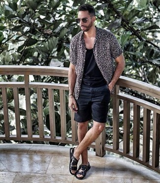 How to Wear Black Shorts For Men: This casual combination of a white leopard short sleeve shirt and black shorts is super easy to throw together in next to no time, helping you look dapper and ready for anything without spending too much time combing through your wardrobe. Complete your getup with a pair of black leather sandals to instantly bump up the appeal of your look.
