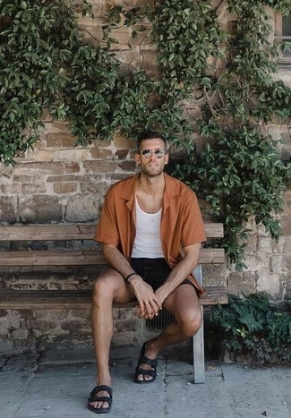 White Tank Outfits For Men: The go-to for a knockout casual ensemble? A white tank with black shorts. Don't know how to round off? Grab a pair of black leather sandals for a more laid-back twist.